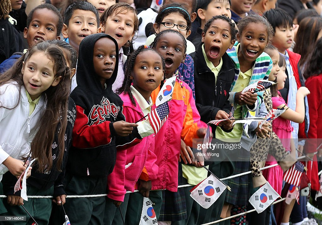 Children watch the start of an arrival ceremony for President Lee Myung-bak of the Republic of Korea at the White House hosted by U.S. President Barack Obama October 13, 2011 in Washington, DC. Later in the day Lee is scheduled to hold a joint press conference with Obama and also address a joint meeting of Congress.