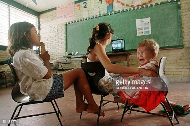 Children watch TV 09 November in a school turned into a shelter for flood victims in Tipitapa 22Km north of Managua Nicaragua Hundreds of people who...