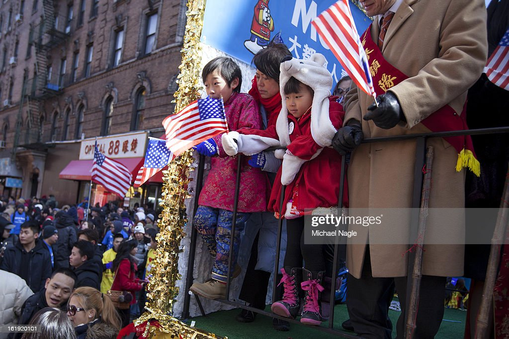 Children watched lion dancers from a float before the start of the 14th Annual Chinatown Lunar New Year Parade on February 17, 2013 in New York City. This year celebrates the Year of the Snake.