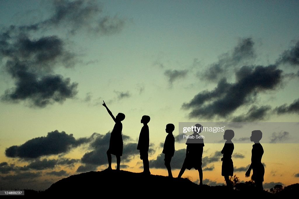 Children watching monsoon cloud formation