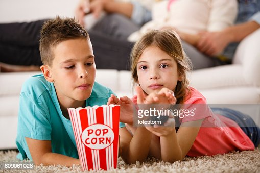 kids watching tv and eating. keywords kids watching tv and eating e