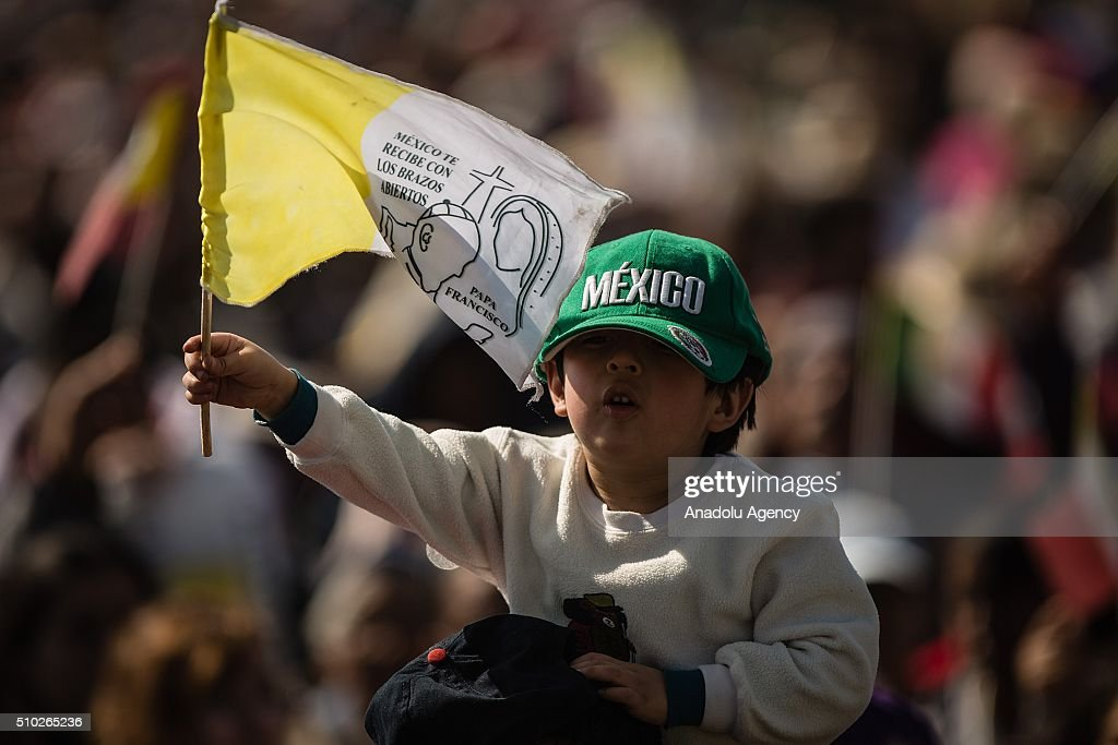 A children wave flag before the mass of Pope Francis in Ecatepec in his Pastoral Visit to Mexico. In Ecatepec, Mexico on February 14, 2016.