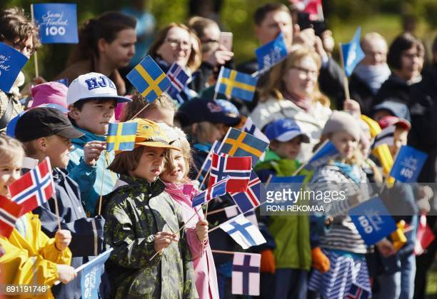 Children wave flags at the Sibelius monument during the visit of the Nordic heads of state in Helsinki on June 1 2017 Nordic heads of state are...