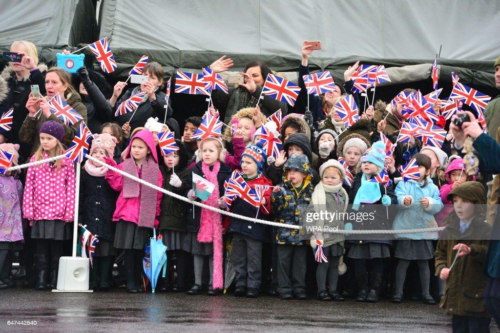 children-wave-flags-during-queen-elizabeth-iis-visit-to-present-leeks-picture-id647442540