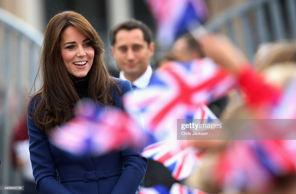 Children wave Union Jacks as Catherine Duchess of Cambridge arrives at RSS Discovery as part of an away day to the Scottish City on October 23 2015...