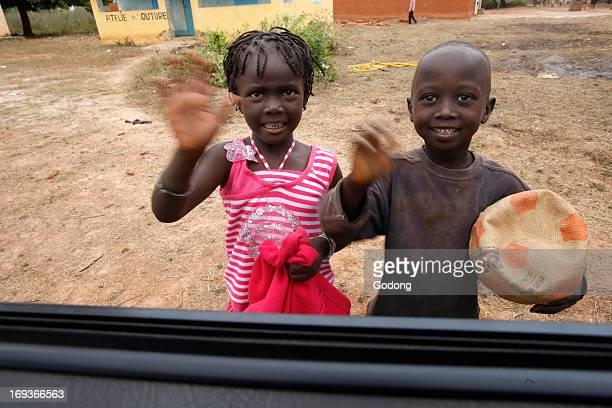 Children waving goodbye Senegal