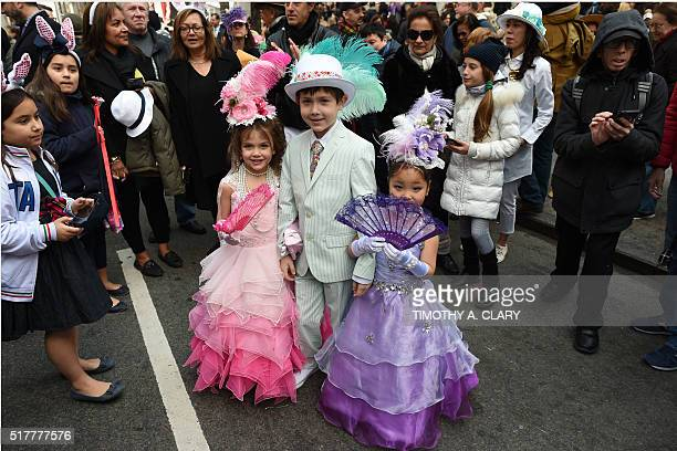 Children wear their Easter finery as they walk down Fifth Avenue in New York during the annual Easter Parade and Easter Bonnet Festival March 27 2016...