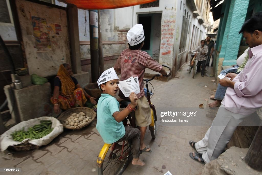 Children wearing AAP caps distributed by AAP volunteers during an election campaign on April 22, 2014 in Varanasi, India. Narendra Modi will file his nomination from Varanasi on April 24. His rival contestants are Aam Aadmi Party leader Arvind Kejriwal, Ajay Rai of the Congress and Kailash Chaurasia of the Samajwadi Party