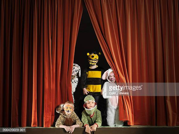 Children (5-7) wearing animal costumes on stage, portrait