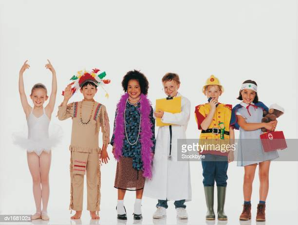 Children wearing costumes, standing in row