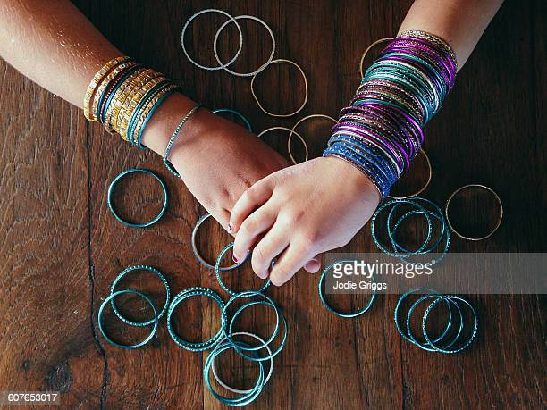 Children wearing lots of colourful bracelets
