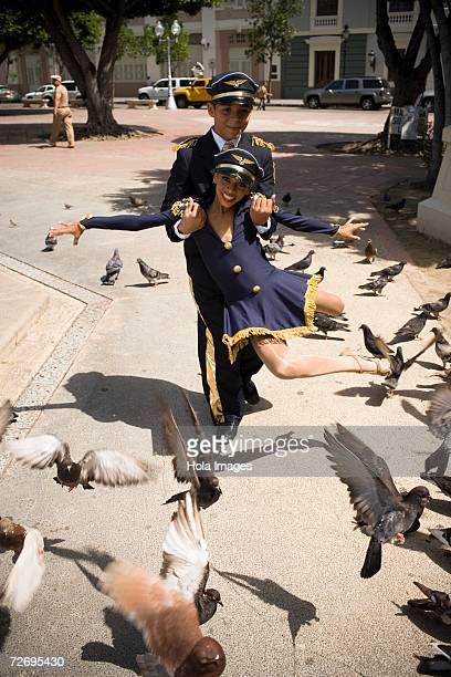 Children wearing pilot and flight attendant costume dancing salsa