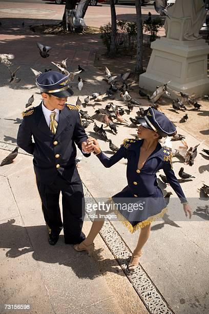 Children wearing pilot and flight attendant costume
