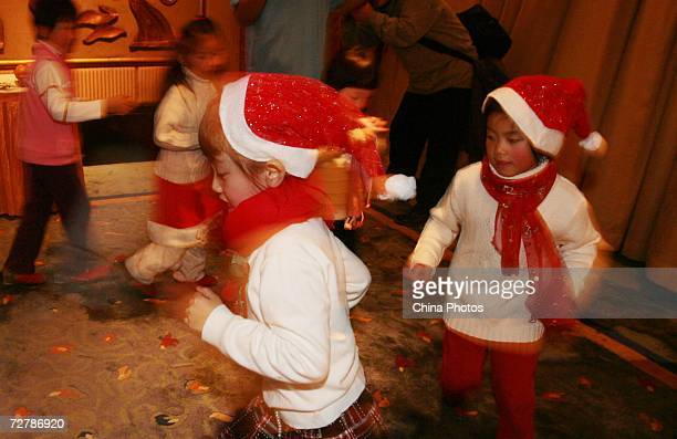 Children wearing Santa Claus's caps play at kindergarten on December 9 2006 in Nanjing of Jiangsu Province China Western traditions such as the...
