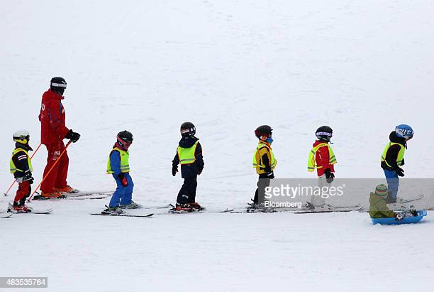 Children wearing skis take part in a ski school at the Niseko Hanazono resort operated by Nihon Harmony Resorts KK in Kutchan Hokkaido Japan on...