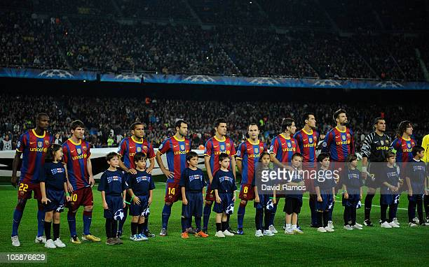 Children wearing 'United against Racism' Tshirts pose with Barcelona players prior the start of the UEFA Champions League group D match between...