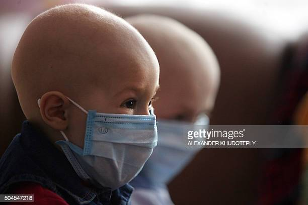 A children wears a mask at a hospital for people suffering from leukemia in the eastern Ukrainian city of Donetsk on March 23 2011 Ukrainian children...