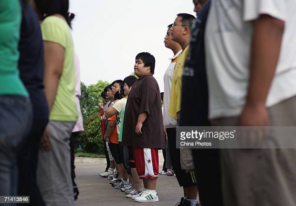 Children who attend a weightlosing summer camp organized by the Aimin Slimming Centre receive military training July 10 2006 in Wuhan of Hubei...