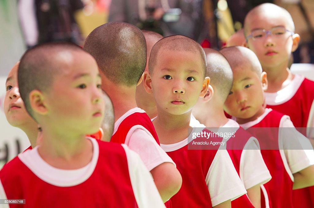 Children who entered temples to have an experience of monks' life for weeks, take part in the Little Monk Soccer Match under lanterns at Jogye temple on May 4, 2016 in Seoul, South Korea.