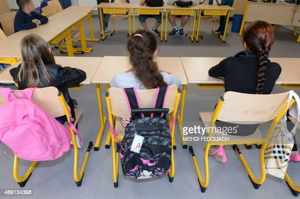 Children wit in a classroom at the Condorcet school in Bordeaux southern France on September 1 the first day of the new school year AFP PHOTO / MEHDI...