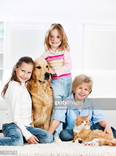 Children with animals at home.