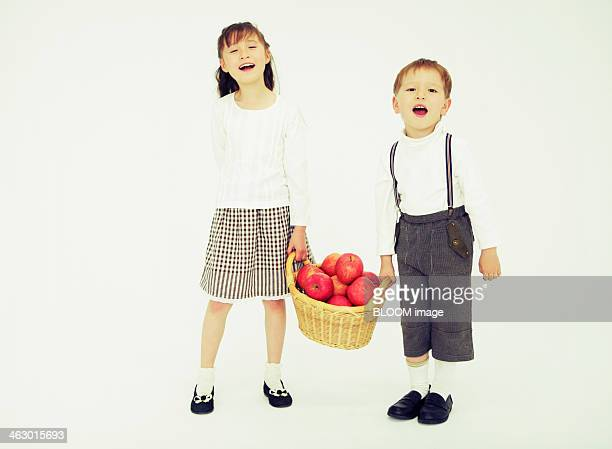 Children With Apple Of Basket