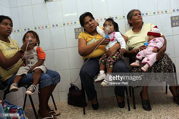 Children with asthma and other chronic illnesses receive oxygen in a hospital ward on July 19 2012 in Tegucigalpa Honduras Honduras now has the...