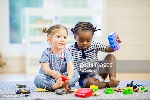 Children with Blocks and Plastic Animals