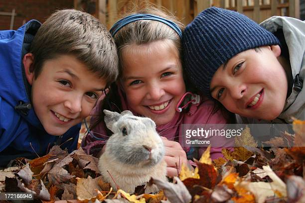 Children with bunny in the leaves