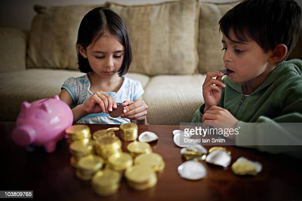 Children with chocolate gold coins