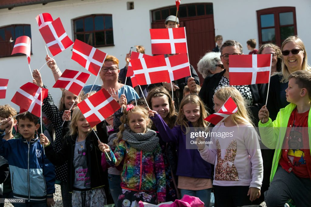 Children with Dannbebrog flag wait for Queen Margrethe of Denmark to arrive at at a nature reserve during her visit on June 14, 2017 in Kalundborg, Denmark. Queen Margrethe is on a two days visit to Kalundborg. The Queen arrived to the Danish harbour city on board the Royalship Dannebrog and continue the trip to Mariaager for another two days visit wich begins June 15.