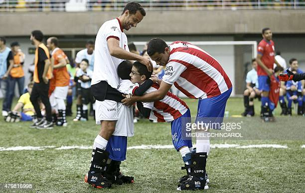 Children with different capabilities and professional athletes participate in the project 'Bota do Mundo' of the Neymar Project Institute in Praia...
