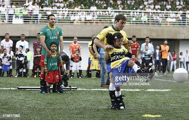Children with different capabilities and professional athletes take part in the project 'Bota do Mundo' of the Neymar Project Institute in Praia...