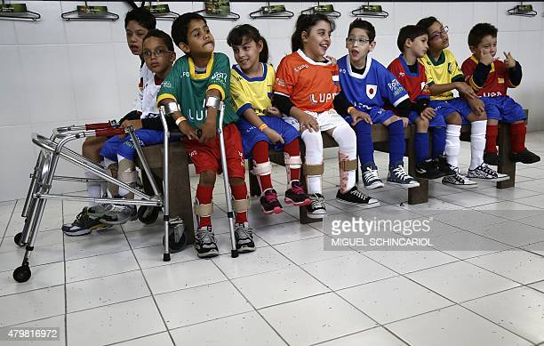 Children with different capabilities pose during the project 'Bota do Mundo' of the Neymar Project Institute in Praia Grande Sao Paulo Brazil on July...