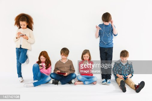 Children with different gadgets