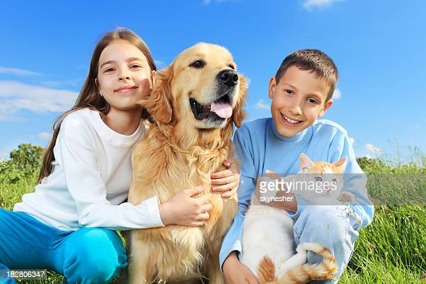 Children with dog and cat outside.