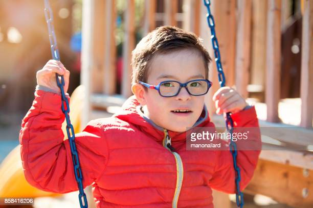 Children with down syndrome happy outdoors