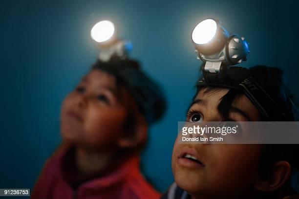 Children with head torches