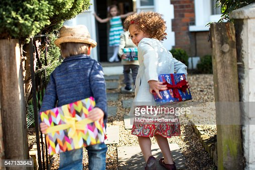 Children With Presents Arriving At Birthday Party Stock ...