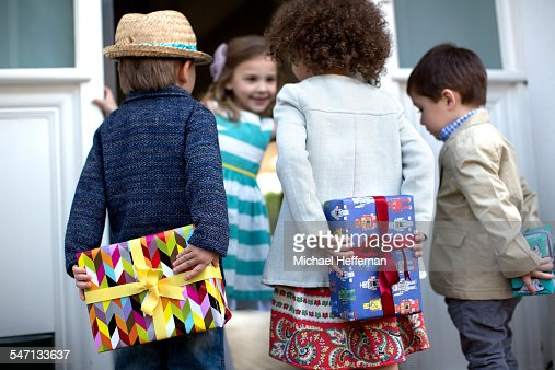Children With Presents Arriving At Party Photo | Getty Images