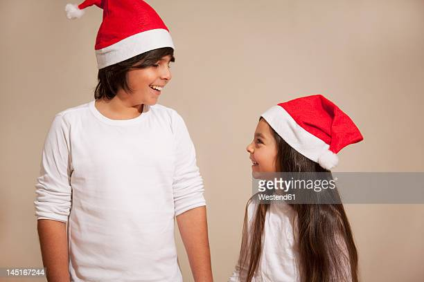 Children with santa hat, smiling