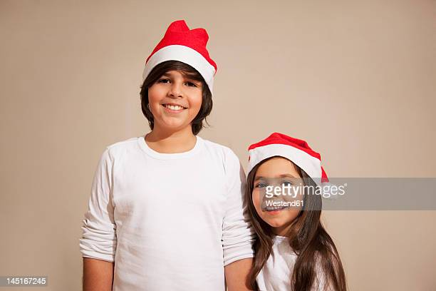 Children with santa hat, smiling, portrait