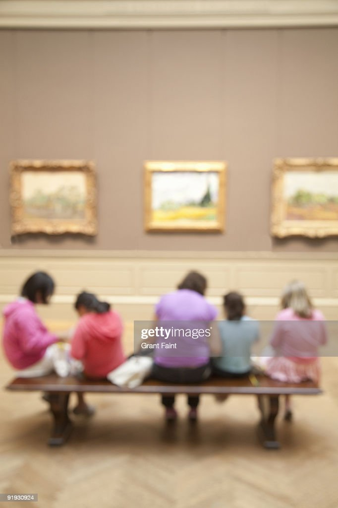 children with teacher observing in art museum : Stock Photo