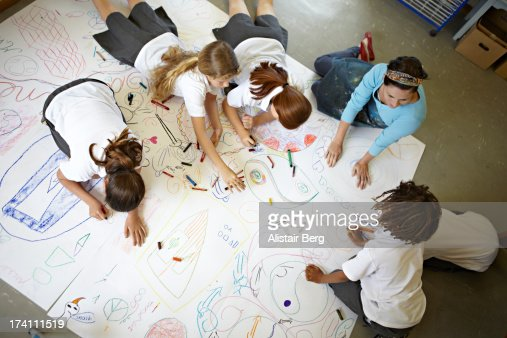 Children working on a large drawing together