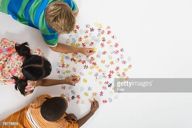 Children Working on Jigsaw Puzzle