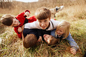 Children wrestling in field