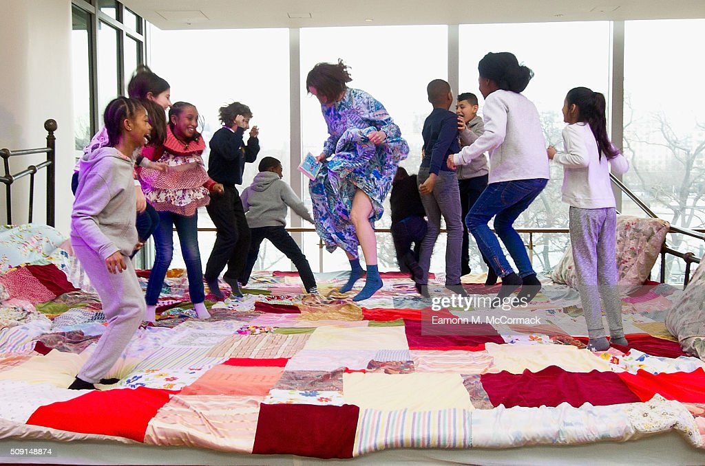 Childrens Author Laura Dockrill jumps on the Giant Storytelling Bed as Children explore the 'World of Roald Dahl' as part of Southbank Centre's annual Imagine Children's Festival at Southbank Centre on February 9, 2016 in London, England.