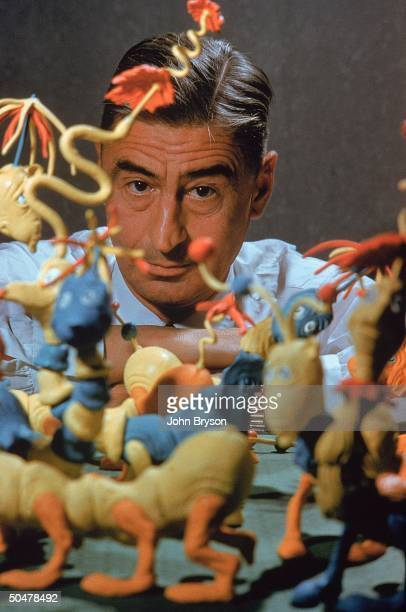 Children's book author/illustrator Theodor Seuss Geisel posing with models of characters he has created