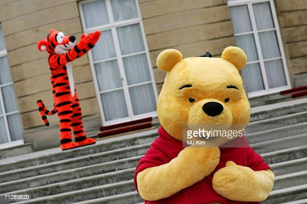 Children's cartoon characters Winnie the Pooh and Tigger are at the Queens garden in Buckingham Palace during the preparation for the Childrens Party...
