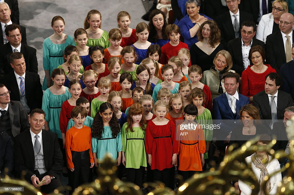 A childrens choir sings during the Nieuwe Kerk or New Church in Amsterdam for the inauguration of Dutch King Willem-Alexander on April 30, 2013.